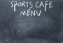 Sports cafe menu title written with chalk on blackboard Stock Photos