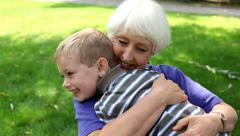 Senior woman and young boy - stock footage