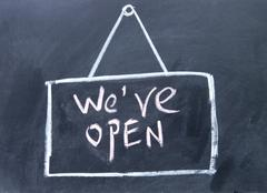 We are open  sign drawn with chalk on blackboard Stock Photos