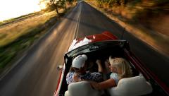 Couple in convertible car driving Stock Footage