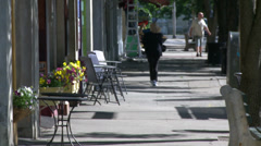 Daily hustle and bustle in the village (1 of 7) - stock footage