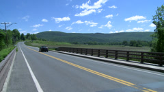 Long, smooth country road Stock Footage