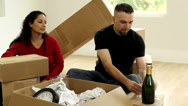 Stock Video Footage of Couple with unpacked boxes toasting