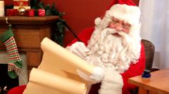 Santa Claus writing on scroll Stock Footage