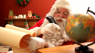 Stock Video Footage of Santa Claus looking at antique globe