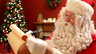 Stock Video Footage of Santa Claus writes on list