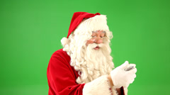 Santa Claus talking on cell phone - stock footage