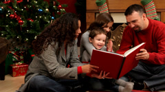 Family reading Christmas book together - stock footage