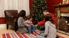 Family giving Christmas gifts - stock footage