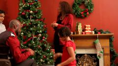 Family decorating Christmas tree - stock footage