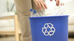 Putting plastic bottles in recycle bin Stock Footage