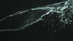 Water on black background, slow motion Stock Footage
