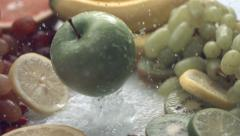 Apple falling into pile of fruit. Slow motion. - stock footage