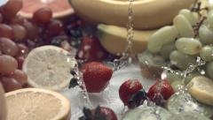 Strawberries and fruit in water, slow motion Stock Footage