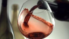 Red wine pouring, slow motion - stock footage