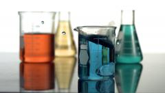 Science beaker splash, slow motion Stock Footage