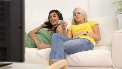 Two teen girls watching TV Stock Footage