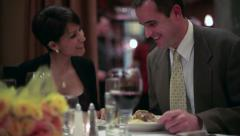 Couple enjoying dinner at a fancy restaurant - stock footage