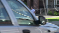Jogging through town (3 of 3) Stock Footage