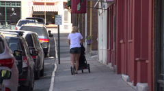 Lady walking with a stroller (1 of 2) Stock Footage