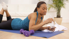 Stock Video Footage of Woman at home resting after workout