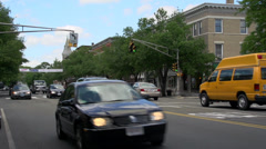 Automobiles passing through an intersection (6 of 6) Stock Footage