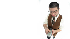 Nerdy guy texting with old phone Stock Footage