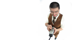 Nerdy guy with old cell phone Stock Footage