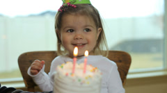 Little girl at a birthday party - stock footage