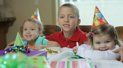Three friends at a birthday party Stock Footage