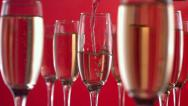 Stock Video Footage of Pouring champagne on red background, slow motion