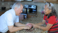 Stock Video Footage of Elderly Asian couple eating chocolates together