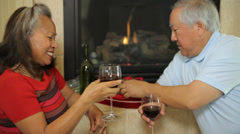 Elderly Asian couple celebrating on Valentines Day Stock Footage