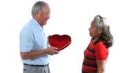 Stock Video Footage of Elderly Asian couple with love heart against white background