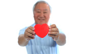 Stock Video Footage of Elderly Asian man with love heart against white background