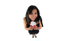 Happy hispanic girl receiving gift against white background Stock Footage