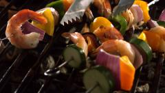 Shrimp and vegetable skewers on grill - stock footage