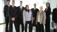 Businesswoman with coworkers in background - stock footage