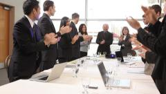 Group of businesspeople clapping - stock footage