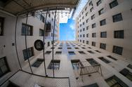 Stock Photo of courtyard view upwards surrounded by buildings