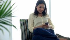 Happy young girl texting on her phone Stock Footage