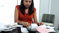 Distressed woman working on personal finances - stock footage