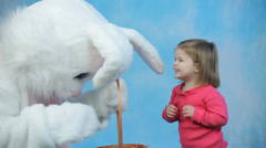 Easter bunny gives eggs to child - stock footage