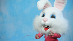 Child wearing Easter bunny head Stock Footage