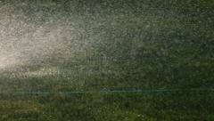 Sprinkler in grass, slow motion Stock Footage