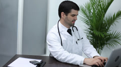 Doctor communicating through laptop - stock footage
