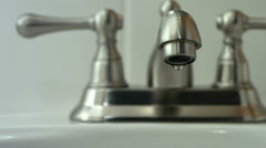 Water drips from faucet, slow motion Stock Footage