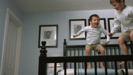 Stock Video Footage of Boys jump on bed, slow motion