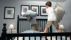 Young boys have pillow fight, slow motion Stock Footage