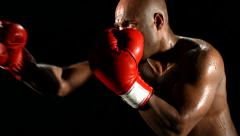 Boxer punching, slow motion - stock footage